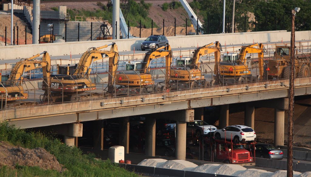 Equipment is lined on Highway 100 before the closure of I-94 at the Zoo Interchange in Milwaukee July 18, 2014. (Rick Wood / Milwaukee Journal Sentinel)