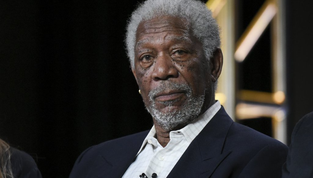 A fake news story claimed that Morgan Freeman said Hillary Clinton should be imprisoned. (AP photo)