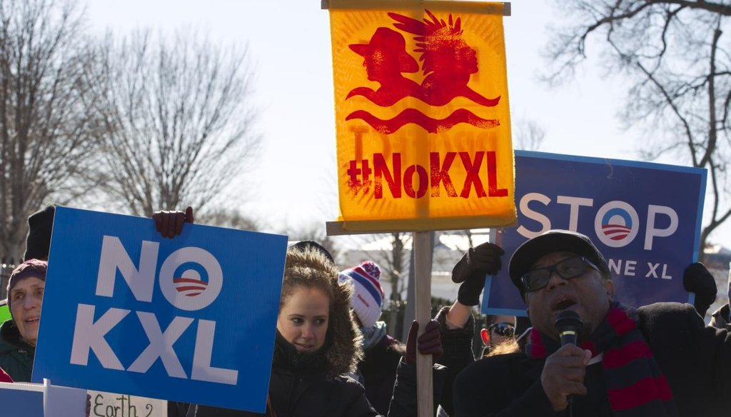 Supporters cheer President Barack Obama's pledge to veto a Keystone XL bill from Congress on Jan. 10, 2015, outside the White House.