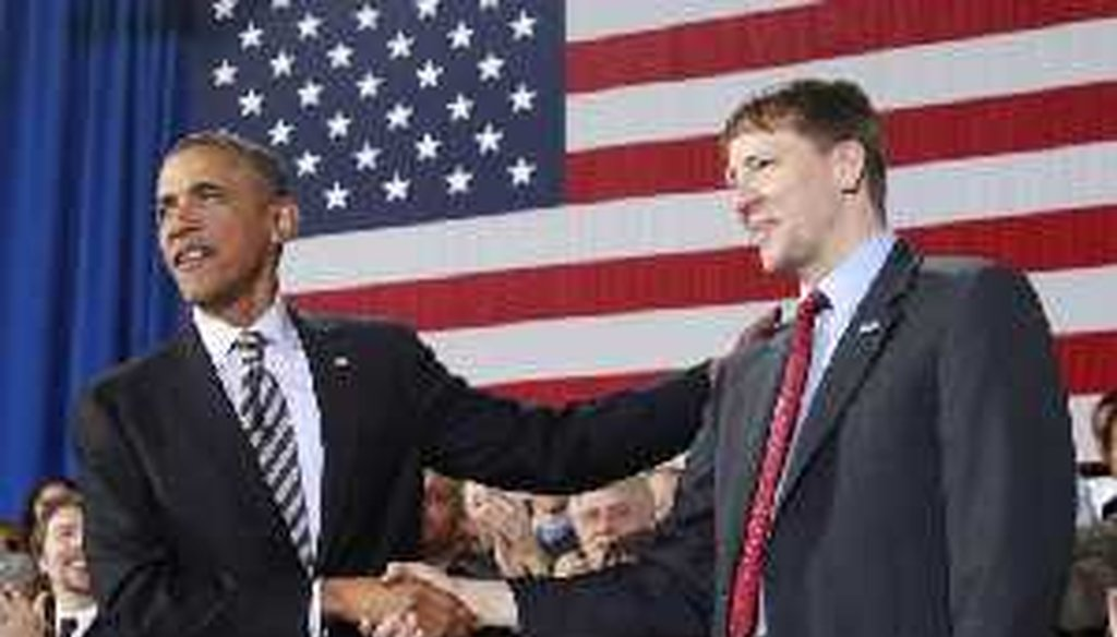 President Barack Obama shakes hands with Richard Cordray Jan. 4 as he announces his recess of Cordray as the first director of the Consumer Financial Protection Bureau.