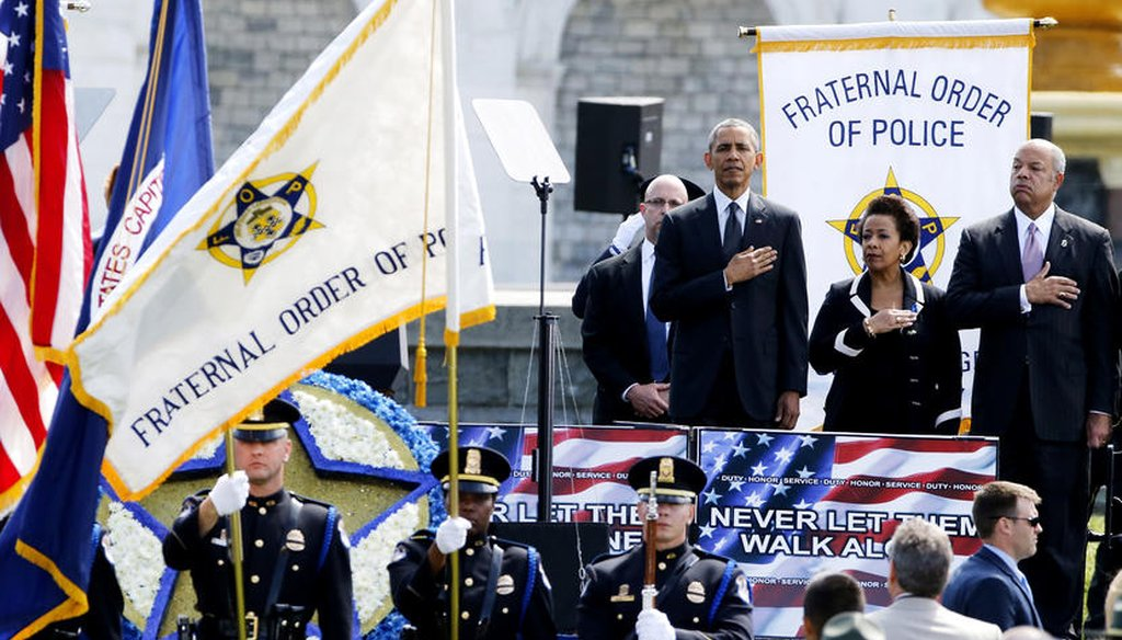 Former President Barack Obama stands for the national anthem at the National Peace Officers' Memorial Service at the U.S. Capitol in Washington May 15, 2015. (Reuters)