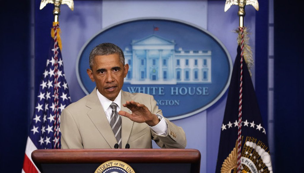 President Barack Obama speaks in the White House press room Aug. 28 ... in a tan suit?