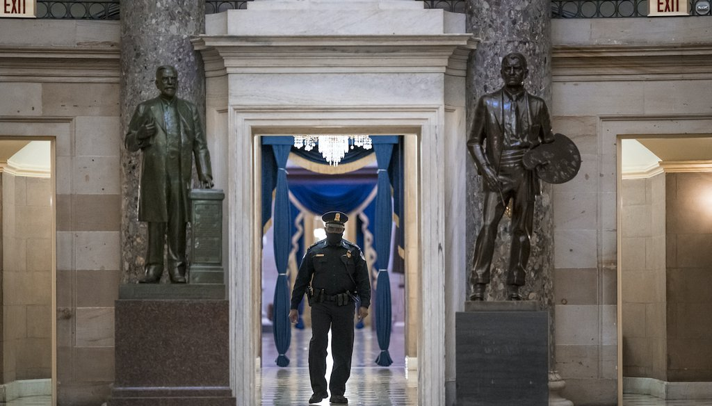 A U.S. Capitol Police officer patrols the area near the House of Representatives chamber after enhanced security protocols were enacted, including metal detectors for lawmakers, Jan. 12, 2021. (AP)