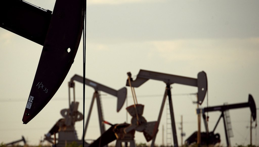 Pumpjacks draw oil out of the ground in a field near Lovington, N.M. (AP Photo/Charlie Riedel)