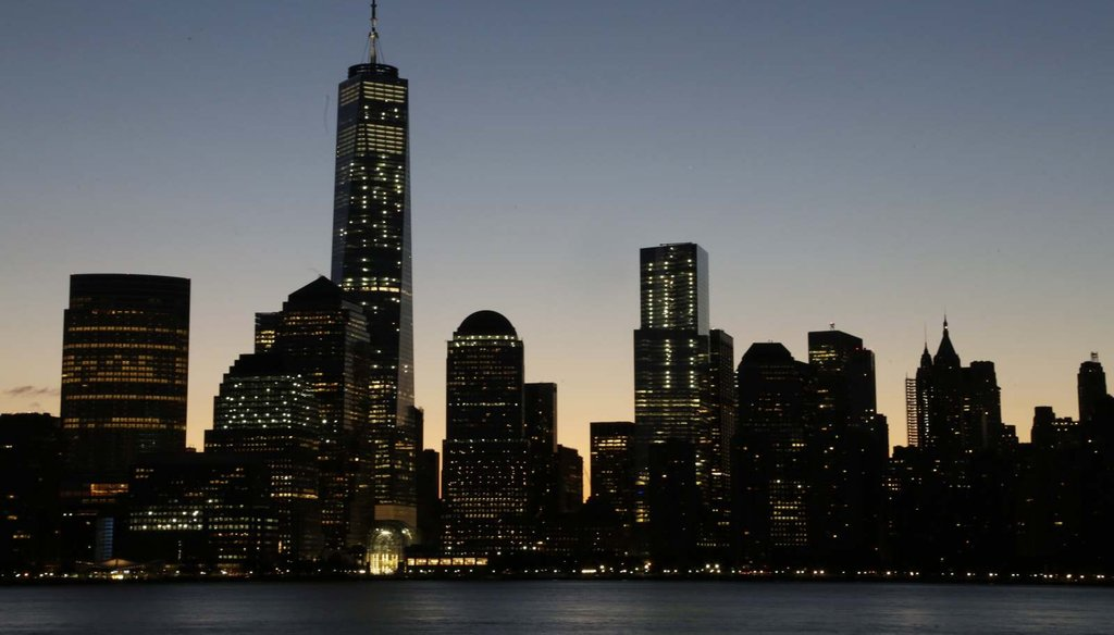 One World Trade Center dominates the lower Manhattan skyline on Nov. 3, 2014 in this view from Jersey City, N.J., 13 years after the 9/11 terrorist attack. (AP Photo/Mark Lennihan)