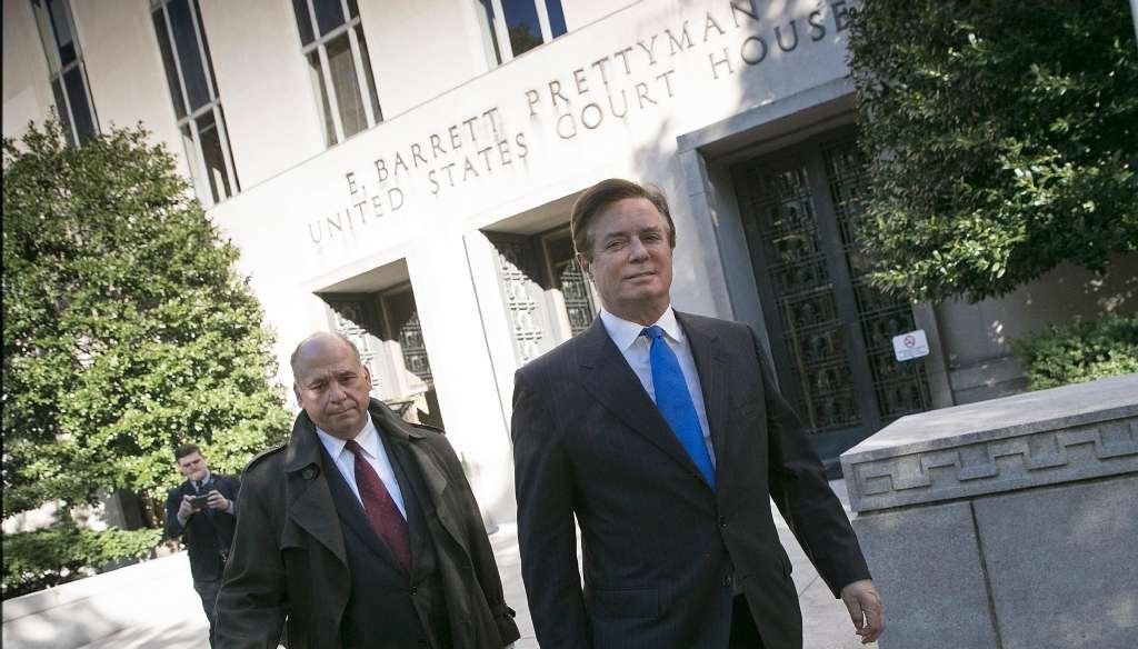 Former Donald Trump campaign manager Paul Manafort, right, leaves U.S. District Court in Washington after pleading not guilty to charges stemming from Robert Mueller's investigation into Russia's meddling in the 2016 elelction. (Getty Images photo)