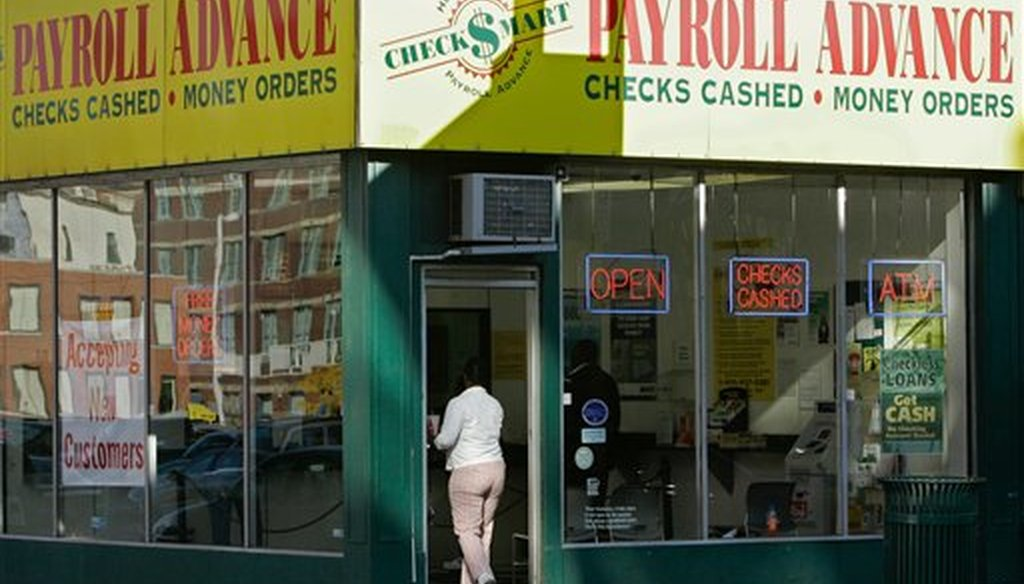 This Nov. 6, 2008 file photo shows a customer entering a Payroll Advance location in Cincinnati, Ohio. (AP)