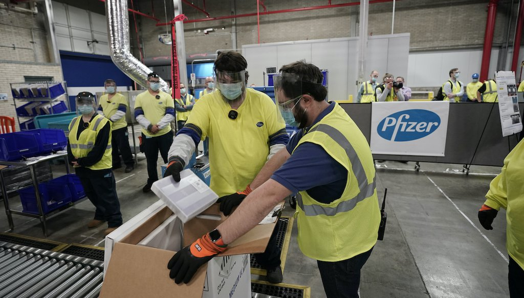 Workers prepare boxes of the Pfizer-BioNTech COVID-19 vaccine for shipment at a Michigan factory, Dec. 13, 2020. (AP)