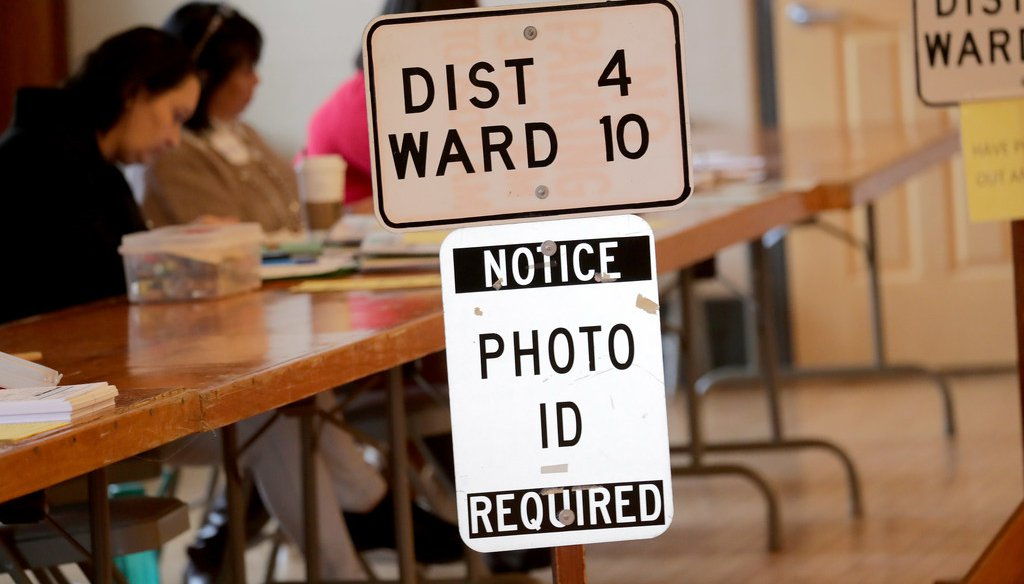 A sign informs voters they need a photo ID to vote at the Hart Park Muellner Buildi­ng in Wauwatosa on Tuesday, Feb. 18, 2020.  (Mike De Sisti/Milwaukee Journal Sentinel)