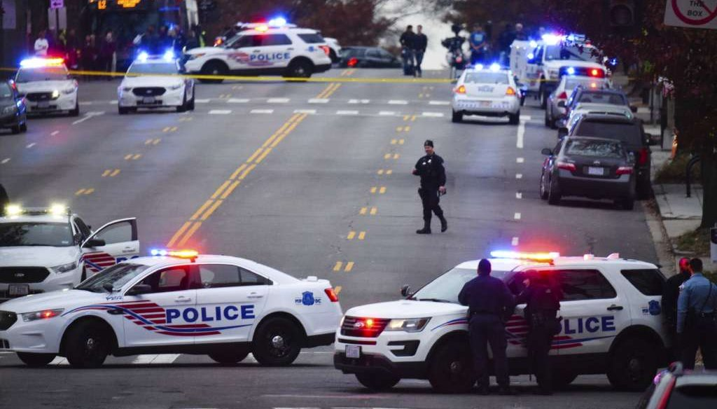 Police secure the street outside Comet Ping Pong in Washington on Dec. 4, 2016. A North Carolina man was arrested after entering the business with a rifle to check on an internet conspiracy theory known as Pizzagate. (AP photo via Washington Post)