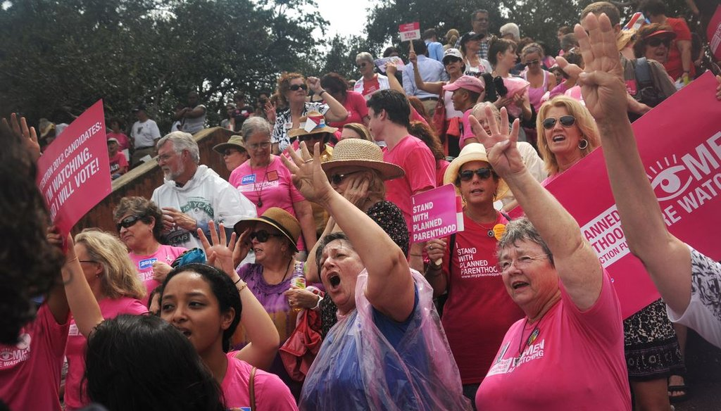 """Planned Parenthood supporters chant """"four more years!"""" during a rally during the second day of the Republican National Convention August 29, 2012 in Tampa, FL. (Leah Millis 