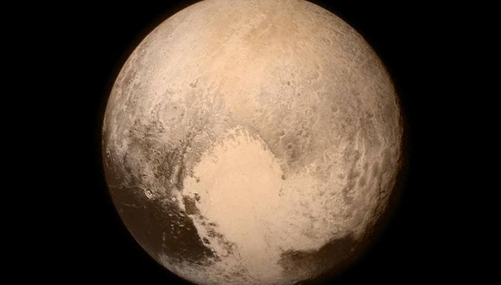 This image sent July 13, 2015, from the New Horizons spacecraft shows the best-ever view of Pluto. A few days later, scientists said the dwarf planet has large frozen plains in its heart-shaped area, which is next to rugged mountains of water ice. (NASA)