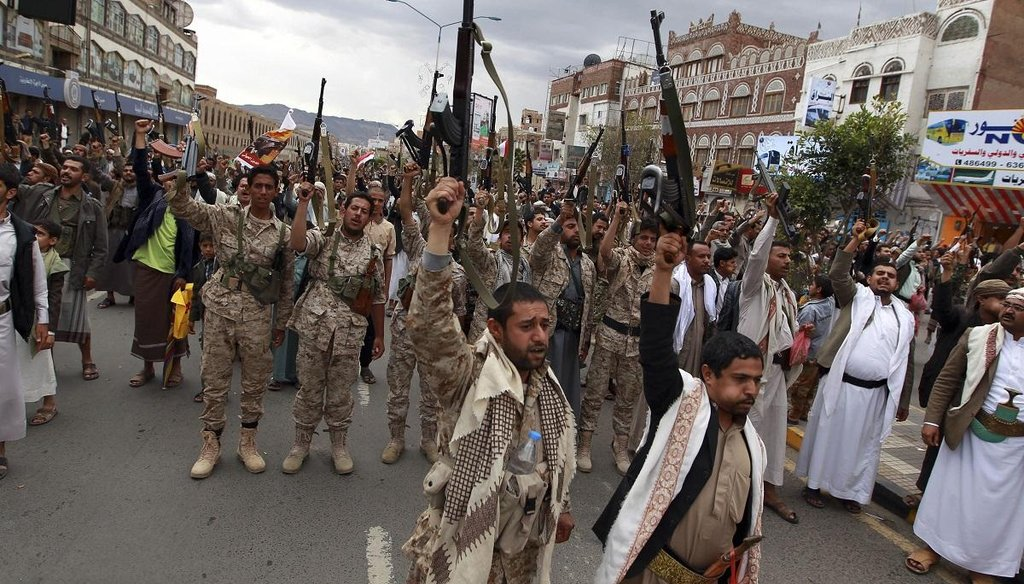Shiite rebels, known as Houthis, hold up their weapons to protest against Saudi-led airstrikes, as they chant slogans during a rally in Sanaa, Yemen, on March 26, 2015. (AP Photo)