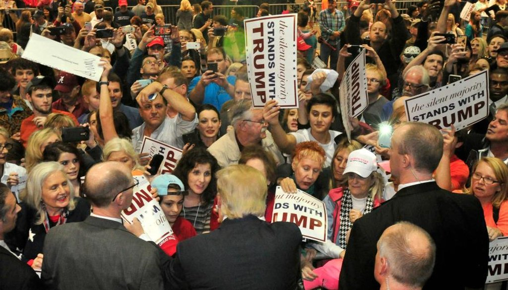 The crowd surges to greet Republican presidential candidate Donald Trump after he speaks Saturday, Nov. 21, 2015 in Birmingham, Ala. A black activist was roughed up after he interrupted Trump at the rally. (AP)