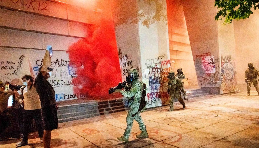Federal officers use crowd control munitions and teargas to disperse Black Lives Matter protesters at the Mark O. Hatfield United States Courthouse on July 21, 2020, in Portland, Ore. (AP)