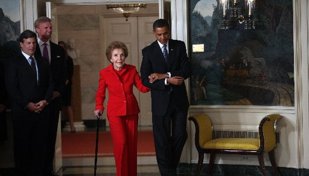 Former first lady Nancy Reagan is escorted by President Barack Obama to the signing of the Ronald Reagan Centennial Commission Act at the White House on June 2, 2009 (New York Times photo).
