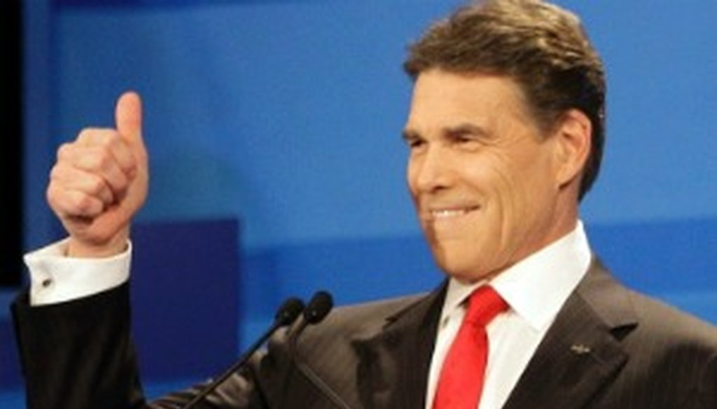 Rick Perry greets the audience before the Dec. 15, 2011, GOP debate in Sioux City, Iowa (Associated Press photo).