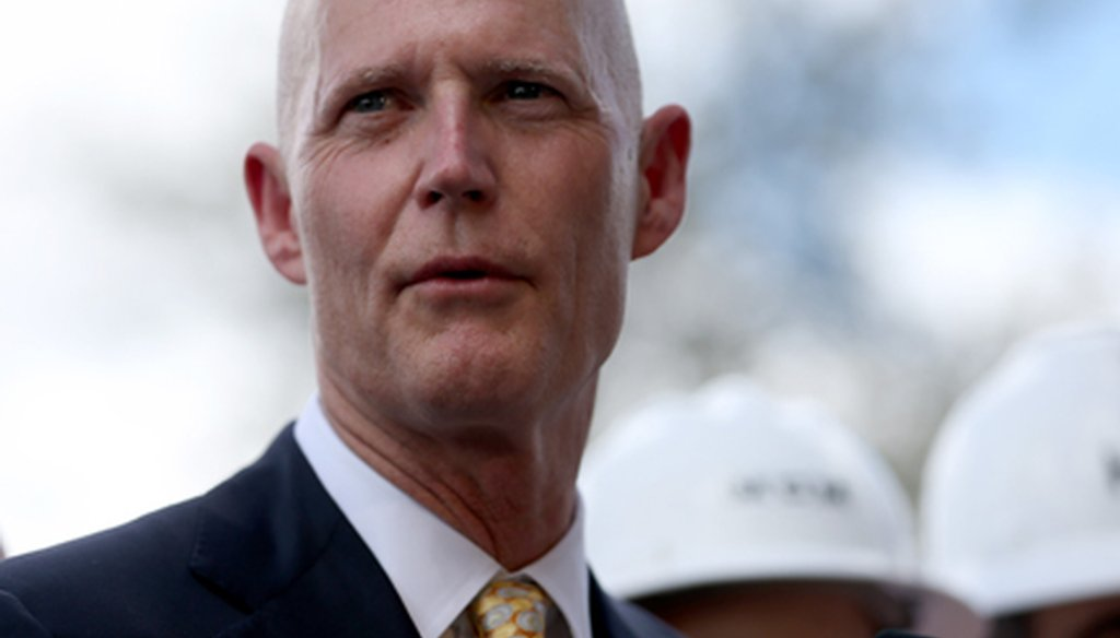 Gov. Rick Scott, shown here in Hialeah in March, has been saying the federal government can't be trusted to follow through on its promises because they ended funding for an experimental Medicaid program. (Getty photo)