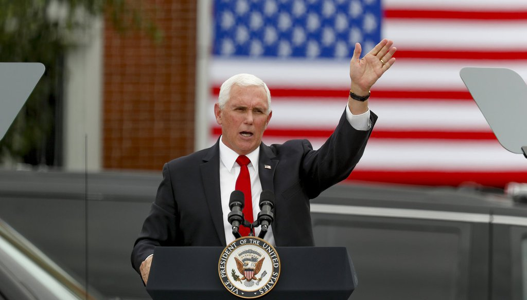 "Vice President Mike Pence waves after he spoke at a ""Cops for Trump"" campaign event at the police station, Thursday, July 30, 2020, in Greensburg, Pa. (AP Photo/Keith Srakocic)"