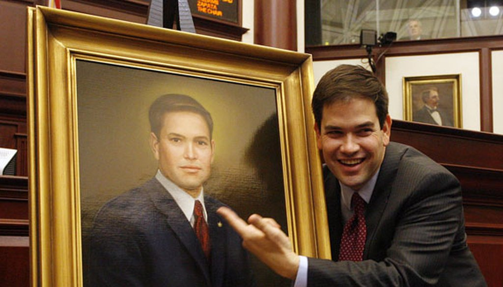 Marco Rubio with his official portrait in the Florida House near the end of his tenure as speaker in May 2008. (Tampa Bay Times file photo)