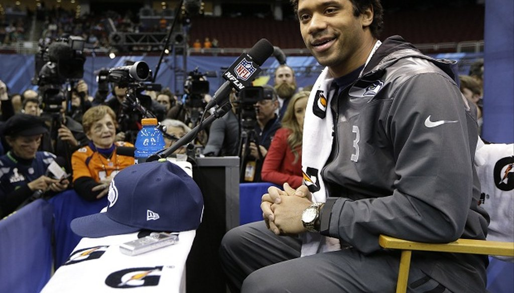 Seattle Seahawks quarterback Russell Wilson talks to members of the media.