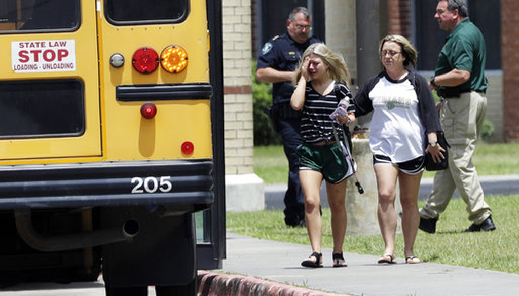 A student, left, reacts after retrieving her belongings inside Santa Fe High School in Santa Fe, Texas, on Saturday, May 19, 2018. Students and teachers were allowed to return to parts of the school to gather their belongings. (AP)