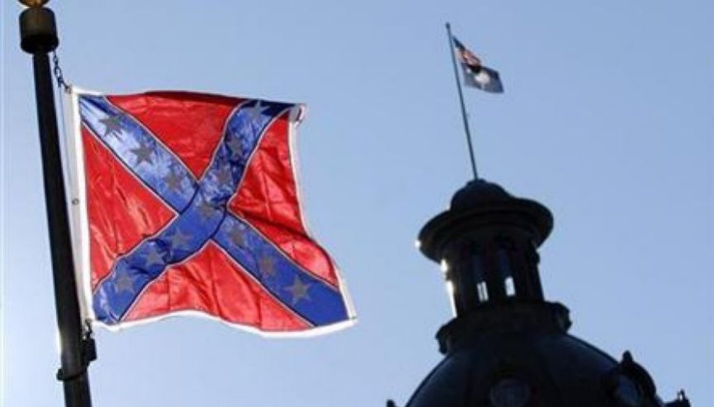The Confederate battle flag flies at a memorial in front of the South Carolina state House. (AP)