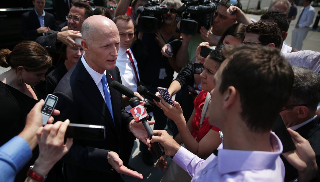 Gov. Rick Scott speaks with reporters in Washington, D.C., after meeting with U.S. Health and Human Services Secretary Sylvia Burwell on May 6, 2015. (Getty Images)