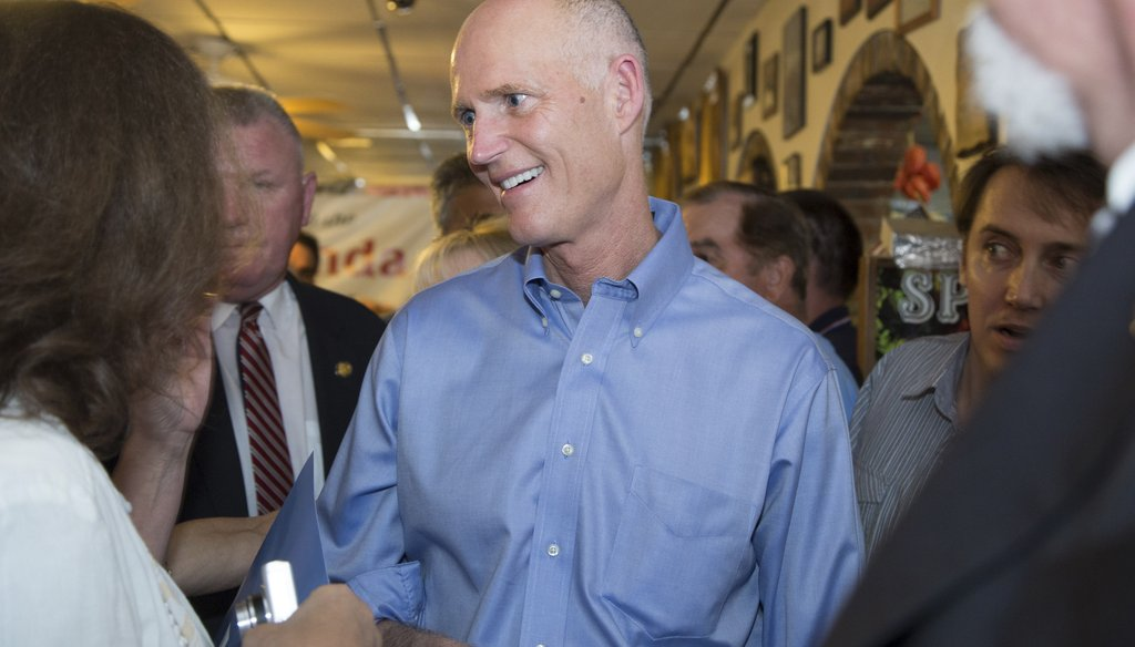 Gov. Rick Scott meets with supporters in Plantation back on Oct. 26, 2014. His jobs promise remained central to his re-election efforts. (New York Times photo)