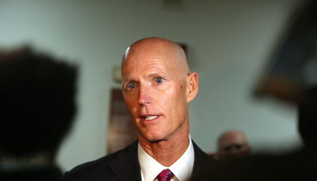 Florida Gov. Rick Scott answers questions after a meeting of the Florida Senate Finance and Tax Committee on Jan. 11, 2016. (Tampa Bay Times photo)