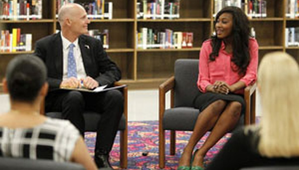 Florida Gov. Rick Scott talks with Jefferson High senior Linda Bamba during his visit to the Tampa school March 26. (Tampa Bay Times photo)