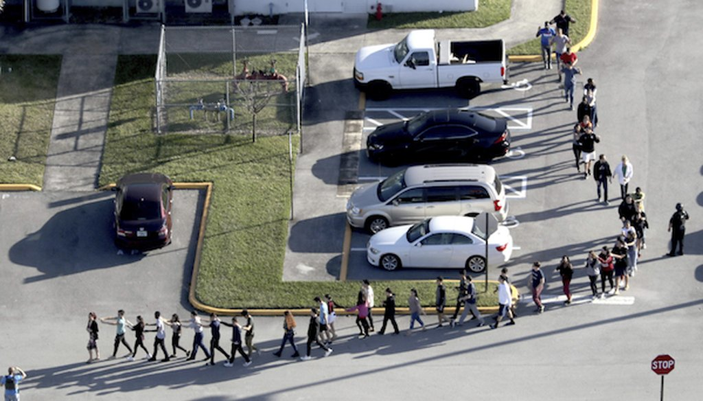 Students are evacuated by police from Marjorie Stoneman Douglas High School in Parkland, Fla., on Wednesday, Feb. 14, 2018, after a shooter opened fire on the campus. (Mike Stocker | South Florida Sun-Sentinel via AP)