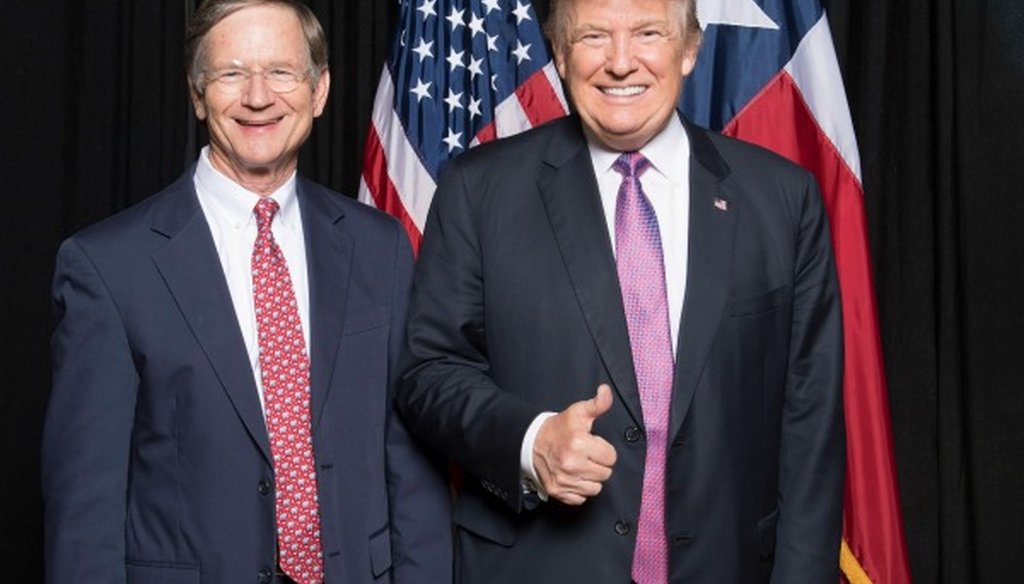 U.S. Rep. Lamar Smith, R-San Antonio, pauses with Donald Trump. We found accurate Smith's claim he was the first member of Congress to donate to Trump's campaign (photo received by email from Jordan Berry, consultant to Smith's campaign, Nov. 11, 2016).