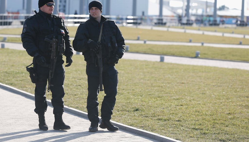 Security officers patrol Olympic Park before opening ceremonies in Sochi on Feb. 7. (Getty)