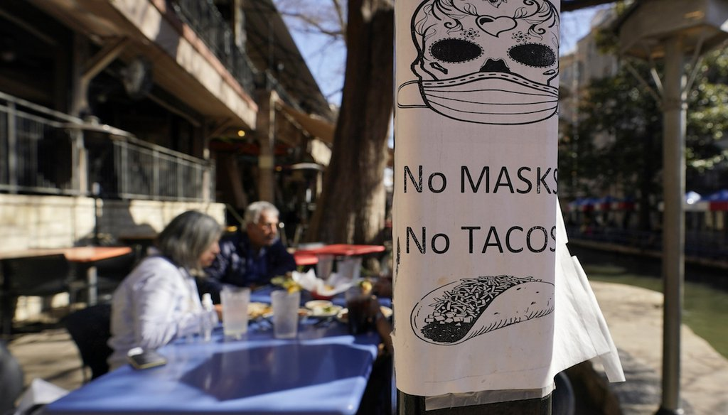 A sign outside a restaurant on the River Walk in San Antonio.  (AP Photo/Eric Gay)