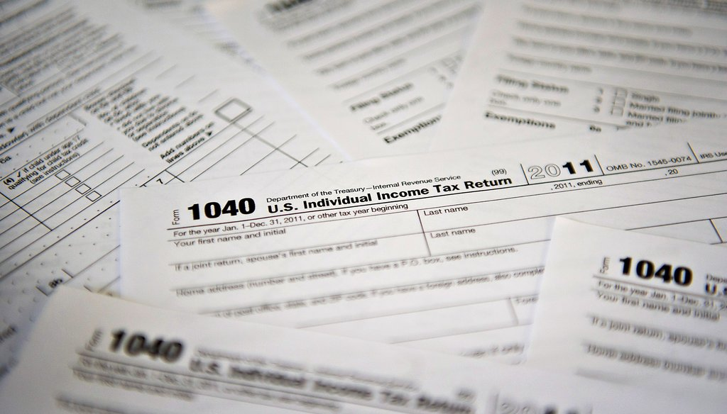The federal tax code has reached almost four million words. Georgia congressman Tom Price, R-Roswell, cites code compliance burdens as reason for comprehensive tax reform. (Photo: Daniel Acker/Bloomberg)
