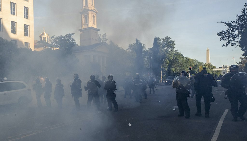 A line of police move demonstrators away from St. John's Church across Lafayette Park from the White House June 1. (AP Photo/Alex Brandon)