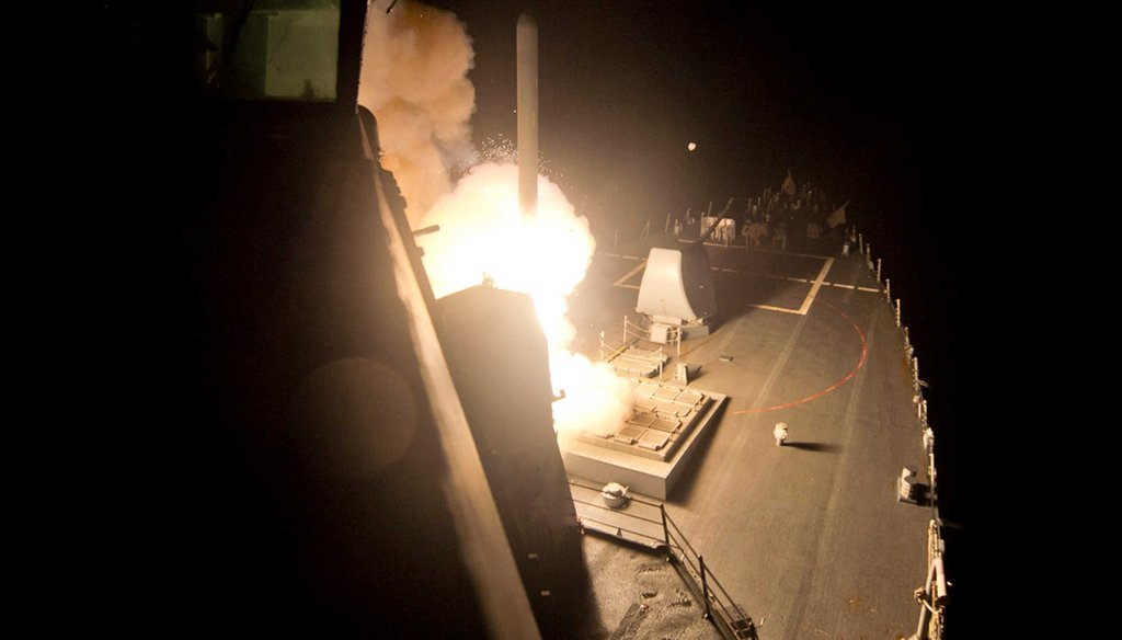 The guided-missile destroyer USS Arleigh Burke (DDG 51) launches Tomahawk cruise missiles on Tuesday, Sept. 23 ,2014, from the Red Sea against Islamic State group targets in Syria. (AP/U.S. Navy)