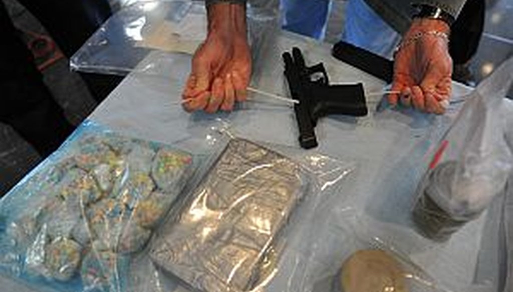 A handgun is displayed along with drugs seized in a raid in 2010. A Customs officer assigned to the Atlanta airport was arrested after taking payoffs to smuggle guns and drug money. Georgia is one of the highest ranking states for gun trafficking.
