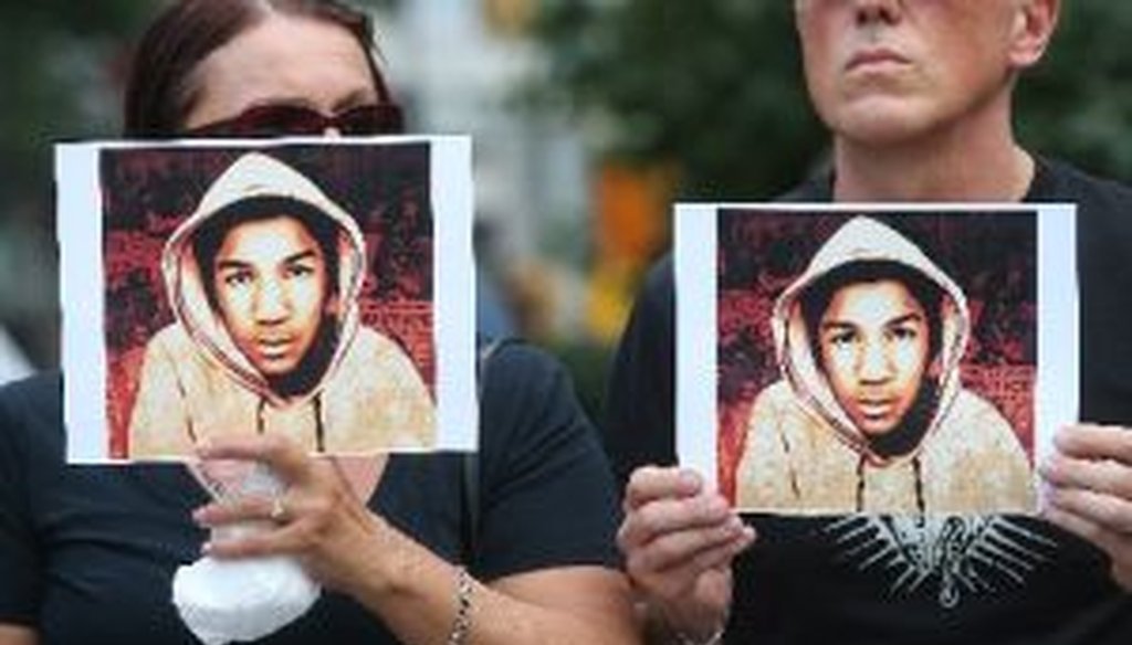 People hold photos of Trayvon Martin at a rally honoring Martin at Union Square in Manhattan on July 14, 2013 in New York City.