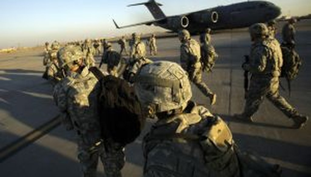 Troops walk toward a C-17 aircraft at Sather Air Base in Iraq. (2010 AP Photo)