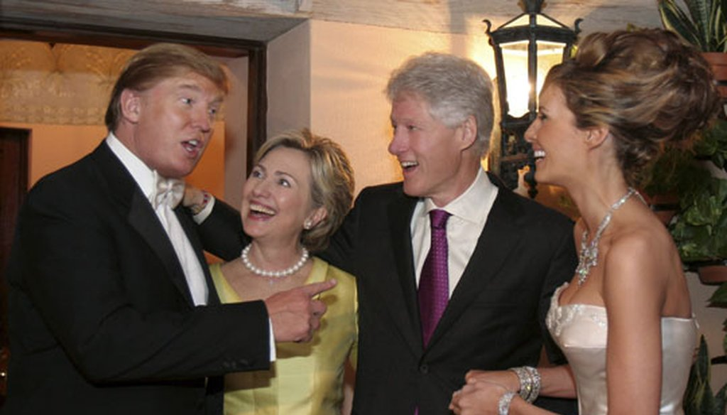 Bill and Hillary Clinton chat with Donald Trump during the reception for his wedding to Melania Knauss in Palm Beach, Fla., on Jan. 22, 2005. (Getty Images)