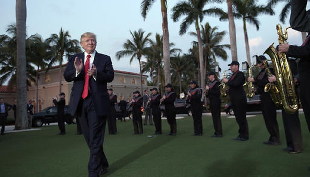 In this Feb. 5, 2017, file photo, U.S. President Donald Trump listens to the Palm Beach Central High School Band as they play at his arrival at Trump International Golf Club in West Palm Beach, Fla. (AP)