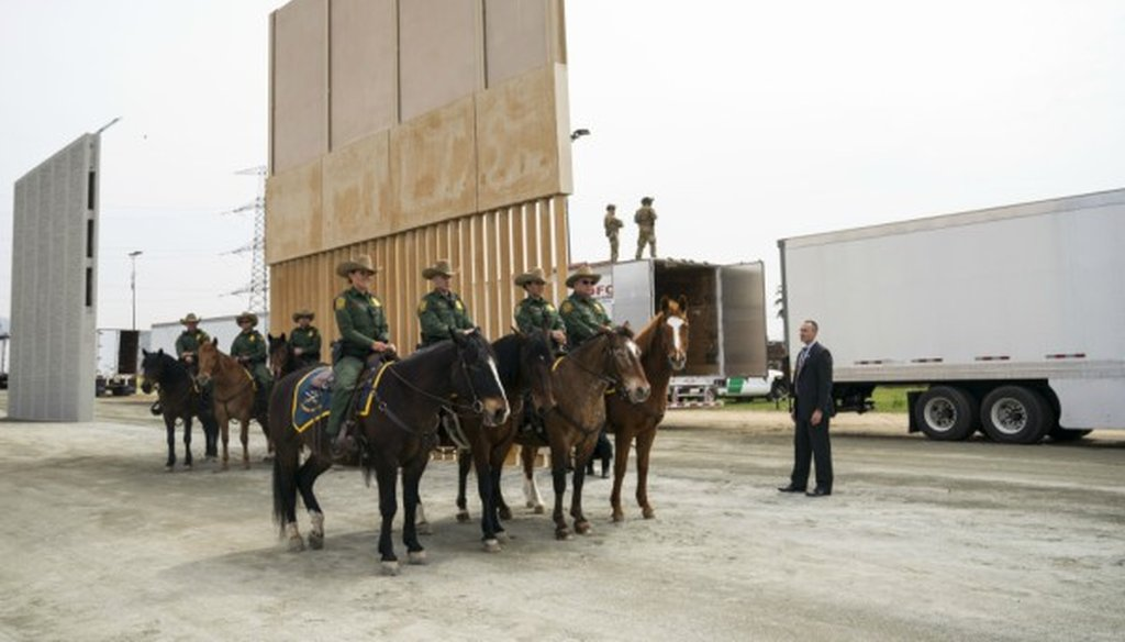 Horse-mounted Border Patrol agents as President Donald Trump views border wall prototypes in the border neighborhood of Otay Mesa near San Diego, March 13, 2018 (Doug Mills/The New York Times).