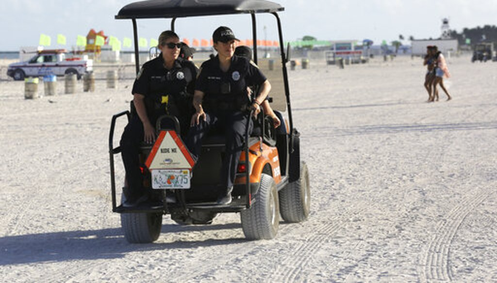 Miami Beach police officers patrol on the beach during spring break, Saturday, March 14, 2020, in Miami Beach, Fla. Portions of South Beach were closed late Saturday to avoid large group gatherings that could spread the coronavirus. (AP)