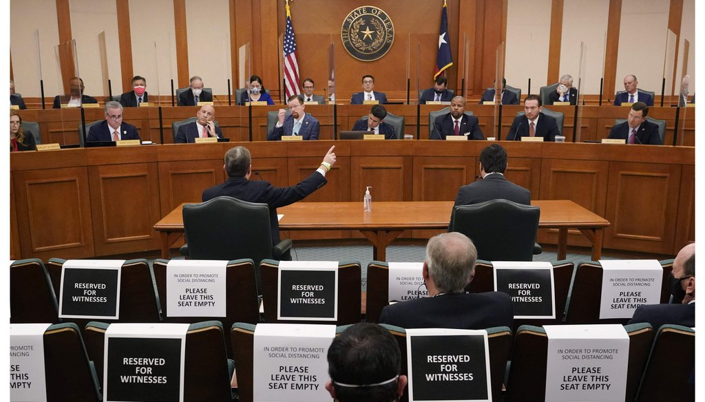 Curtis Morgan, the CEO of Vistra Corp., at table left, testifies as the Committees on State Affairs and Energy Resources holds a joint public hearing to consider the factors that led to statewide electrical blackouts, Feb. 25, 2021, in Austin, Texas (AP)