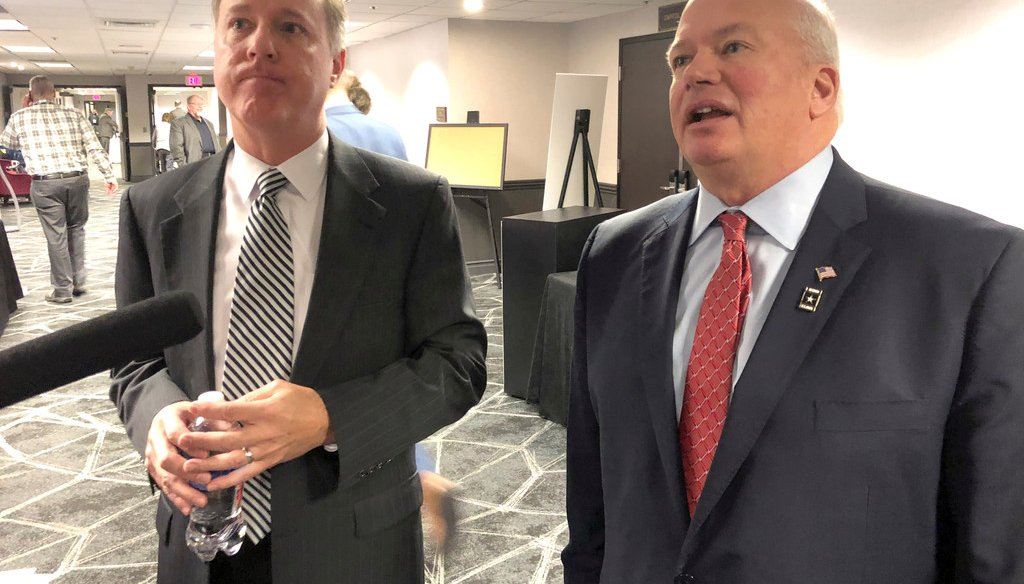 Wisconsin Assembly Speaker Robin Vos, left, and Senate Majority Leader Scott Fitzgerald speak to reporters in Madison about the coronavirus pandemic. (AP Photo/Scott Bauer)