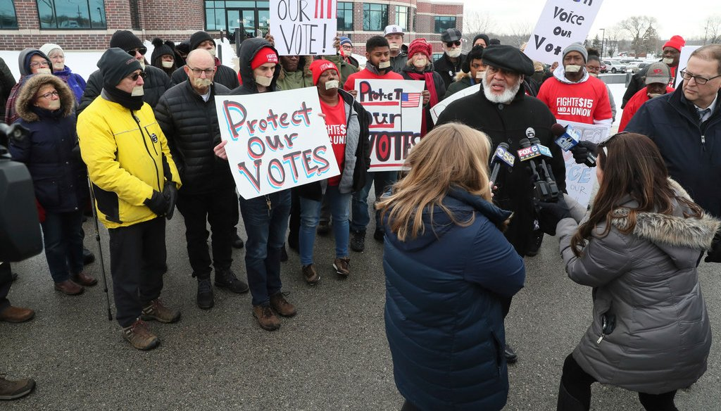 Protestors gather outside the Ozaukee County Courthouse on January 13, 2020, where Ozaukee County Circuit Judge Paul Malloy held state election officials in contempt of court for not removing thousands of people from the voters rolls. (Michael Sears/MJS)