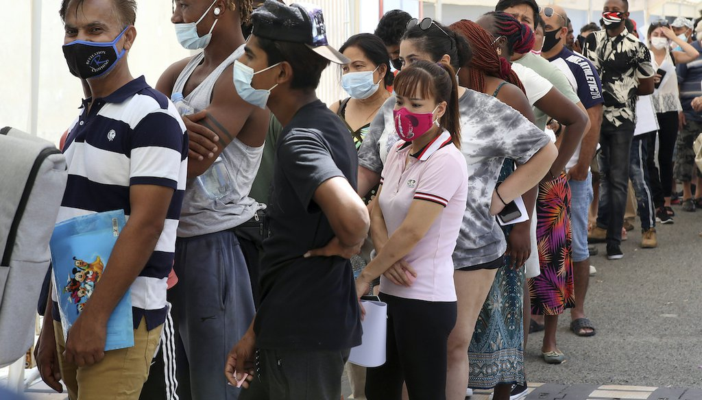 People wait in line to receive a COVID-19 vaccine shot at Cyprus' State Fair in Nicosia, Cyprus, Aug. 13, 2021. (AP)