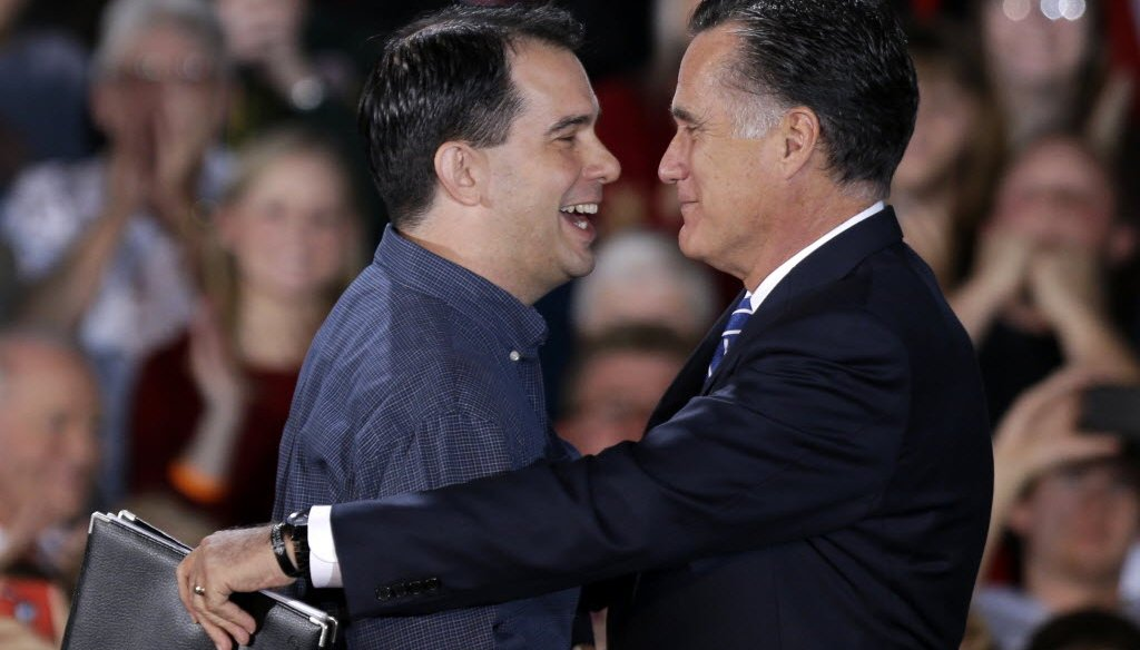 Republican presidential candidate Mitt Romney embraces Gov. Scott Walker at a 2012 campaign event in West Allis. (AP Photo)